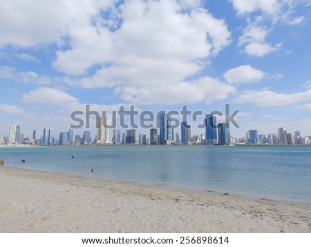 DUBAI, UAE - FEBRUARY 02, 2014: Beach and skyscrapers in Dubai marina