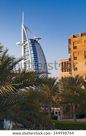 DUBAI, UAE - FEBRUARY 20, 2010: Burj Al Arab viewed from the Madinat Jumeirah, Dubai on February 20, 2010. The hotel is classed as one of the most luxurious in the world.