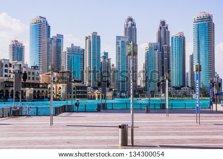 DUBAI, UAE - FEBRUARY 3: Downtown Dubai beyond Burj Khalifa lake taken on February 3, 2013. In the foreground  Souk al Bahar hotel and shopping complex built in traditional Arabic architectural style. - stock photo