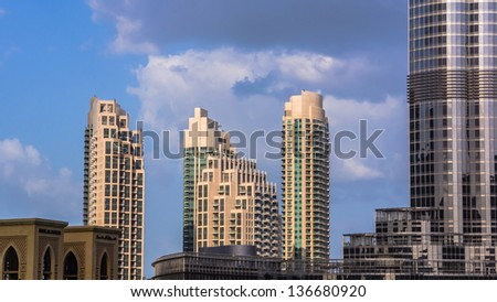 DUBAI, UAE - FEBRUARY 03: Downtown Dubai on February 03, 2013. On the right Burj Khalifa, the tallest man-made structure in the world, at 829.8 m, on the left Souk al Bahar, hotel and shopping mall. - stock photo