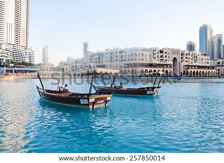 DUBAI, UAE - FEBRUARY 24: Driving by wooden boats near dancing fountains on February 24, 2015 in Dubai - stock photo