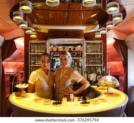 DUBAI, UAE - FEBRUARY 7, 2016: Emirates Airbus A380 in flight cocktail bar and lounge. Emirates is one of two flag carriers of the United Arab Emirates along with Etihad Airways and is based in Dubai - stock photo