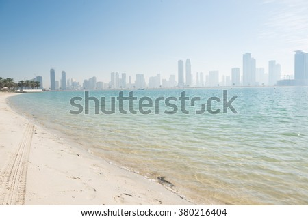 DUBAI, UAE - FEBRUARY 8, 2016: SHARJAH SKYLINE FROM THE AL MAMZAR BEACH PARK