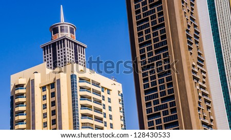 DUBAI, UAE - FEBRUARY 3: Stunning examples of architectural styles in Dubai downtown, UAE, on February 03, 2013. Dubai has a rich collection of amazing buildings and structures of various styles.