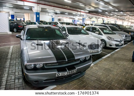 DUBAI, UAE - FEBRUARY 10: Underground parking with cars on February 10, 2014 in Dubai. Parking at mall of the Emirates is a shopping mall in the Al Barsha district of Dubai. - stock photo