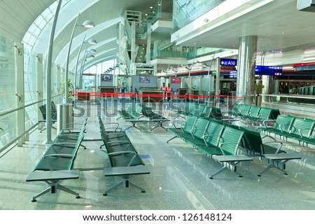 DUBAI, UAE - JAN 6: The newer Terminal 3 (Emirates) at Dubai Airport, one of the busiest airports, on January 6, 2013. It's world largest building by floor space and world largest airport terminal. - stock photo