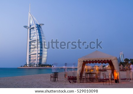 DUBAI,UAE-JAN 22: View of the luxury beach of Dubai at sunset  and Burj al arab on the 22th of january 2010, in Dubai,Uae.