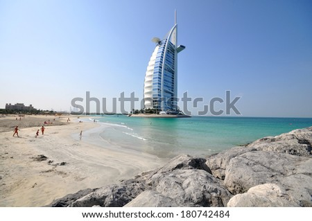 DUBAI, UAE - JANUARY 9, 2013: Burj Al Arab in Dubai, as seen on Jan 9, 2013. It is a 7-star hotel built on an artificial island and is the fourth tallest hotel in the world. - stock photo