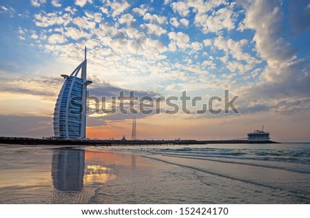 DUBAI, UAE, JANUARY 1: Burj Al Arab on Jumeirah Beach after a big thunderstorm. After the storm all what remains are spectacular clouds in the sky. New Years Day January 01, 2010 - stock photo