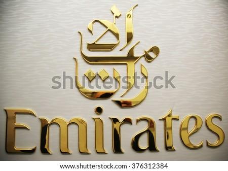 DUBAI, UAE - JANUARY 22, 2016: Emirates Airline logo on Airbus A380 plane at Dubai International  Airport - stock photo