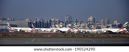 Dubai, UAE - JANUARY 12: Emirates Airlines flights at Dubai International0 Airport Terminal 3 on January 12, 2014. Emirates is an airline based in Dubai. - stock photo