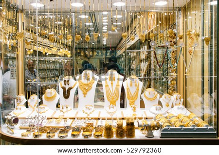 DUBAI,UAE - JANUARY 24: gold and jewel are sold in the Dubai souk on the 24th of january 2010 in Dubai, United Arab Emirates. Gold souk consists of 300 retailers.