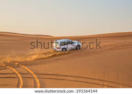 DUBAI, UAE-JANUARY 20: Jeep safari, 20, 2014 in Dubai, UAE. Jeep safari in the Arab desert. - stock photo