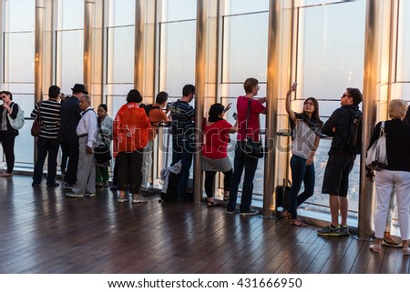DUBAI, UAE - JANUARY 02: people at the top the observation deck of the highest building in the world Burj al Khalifa on January 02, 2015 in Dubai, United Arab Emirates