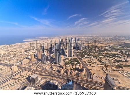 DUBAI, UAE - JANUARY 6: Skyscrapers on Sheikh Zayed Road on January 6, 2013 in Dubai, UAE. View of Downtown Dubai from the height of Burj Khalifa. - stock photo