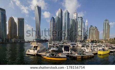 DUBAI, UAE - JANUARY 16, 2014: View at modern skyscrapers in Dubai Marina in Dubai, UAE. When the entire development is complete, it will accommodate more than 120,000 people. - stock photo