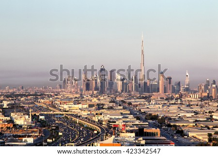 DUBAI, UAE - JANUARY 31, 2015: View of Dubai Skyline showing the Burj Khalifa, the tallest building of the world, seen from the Mall of the Emirates.