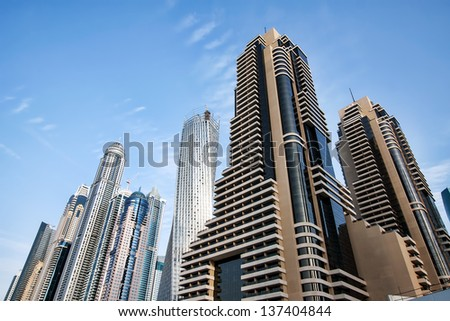 DUBAI, UAE - JANUARY 7: View of modern skyscrapers in Dubai Marina on January 7, 2013 in Dubai, UAE. Dubai Marina - artificial canal city, carved along a 3 km stretch of Persian Gulf shoreline.