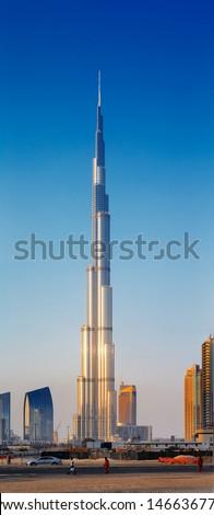 DUBAI, UAE - JUN 19: A skyline view showing the Burj Khalifa on Jun 19, 2013 in Dubai, UAE. Burj Khalifa is the tallest skyscraper in the world, at 829.8 m - stock photo