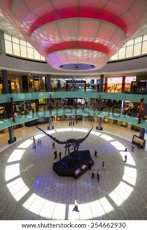 DUBAI, UAE - JUN 5: Shoppers at Dubai Mall on Jun 5, 2014 in Dubai. At over 12 million sq ft, it is the world's largest shopping mall based on total area and 6th largest by gross leasable area.  - stock photo