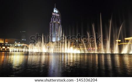 DUBAI, UAE - June 4: A record-setting fountain system set on Burj Khalifa Lake, it shoots water 150 m into the air, at June 4, 2012 in Dubai, United Arab Emirate - stock photo