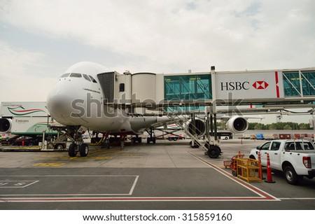 DUBAI, UAE - JUNE 23, 2015: Airbus A380 docked in Dubai airport. Dubai International Airport is an international airport serving Dubai. - stock photo