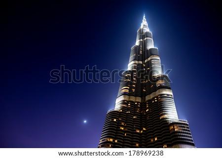 DUBAI, UAE - JUNE 13, 2013 : Burj Khalifa in Dubai, United Arab Emirates. Burj Khalifa Skyscraper in Dubai, United Arab Emirates. Burj Khalifa is the tallest man made structure in the world. - stock photo