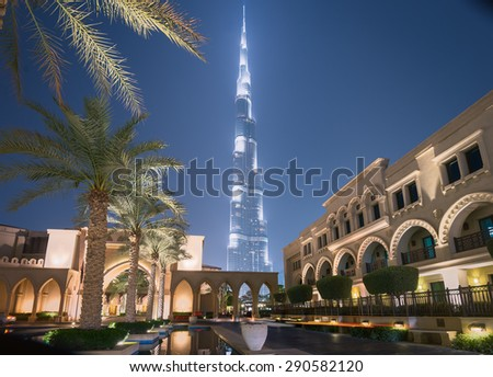 Dubai /UAE - June 5: Burj Khalifa the tallest building in the world standing behind in the famous landmark near by Dubai mall, Dubai fountain show and residentials on June 5,2015 in Dubai. - stock photo