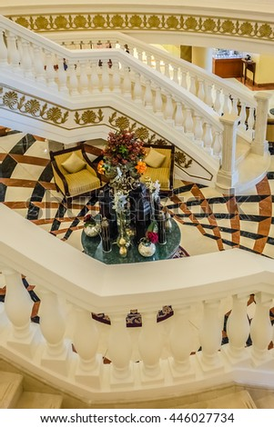 DUBAI, UAE - JUNE 26, 2016: Luxurious interior of Kempinski Hotel and Residences (129 luxury suites, penthouses and villas) on man-made island of Palm Jumeirah. Central staircase. United Arab Emirates - stock photo