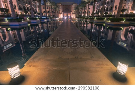 Dubai /UAE - June 5: One entrance to hotels, Burj Khalifa, Dubai mall, Dubai fountain show and Souk Al Bahar on June 5,2015 in Dubai. - stock photo
