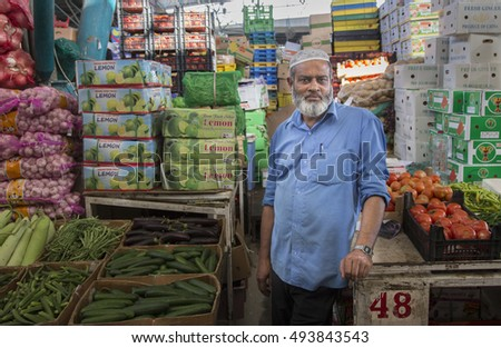 Dubai, UAE, June 3rd, 2016: a man selling vegetables on a market