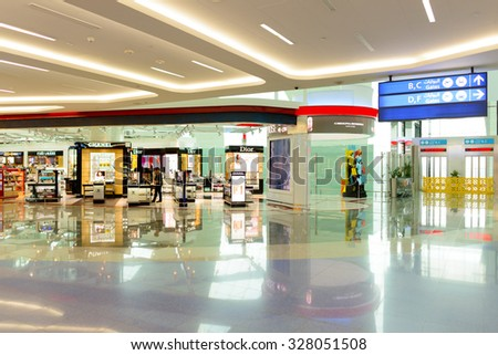 DUBAI, UAE - JUNE 04, 2014: retail area in the concourse A. Dubai Duty Free is the company responsible for the duty-free operations at Dubai International Airport - stock photo