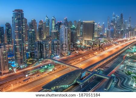 DUBAI, UAE - MAR 23: A skyline panoramic view of Dubai Marina showing the Marina and JBR on Mar 23, 2013 in Dubai, UAE. Dubai Marina is an artificial 3 km canal carved along the Persian Gulf shoreline - stock photo
