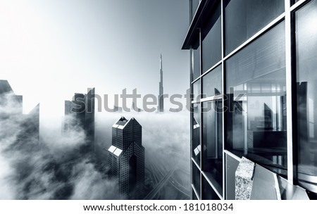DUBAI, UAE - MAR 6: Burj khalifa, the highest building in the world, Downtown is covered by early morning fog on March,6 2014 in Dubai, UAE - stock photo