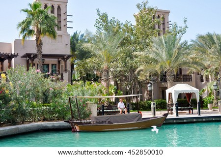 DUBAI,UAE - MARCH 12,2012: a Pleasure boat on a canal in the district of Madinat