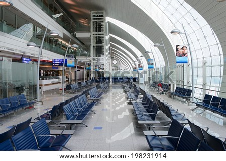 DUBAI, UAE - MARCH 31: airport interior on March 31, 2014 in Dubai. Dubai International Airport is a major airline hub in the Middle East, and is the main airport of Dubai. - stock photo