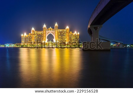 DUBAI, UAE - MARCH 31, 2014: Atlantis hotel iluminated at night in Dubai, United Arab Emirates. Atlantis the Palm is a luxury 5 star hotel built on an artificial island with over 1,500 guestrooms. - stock photo