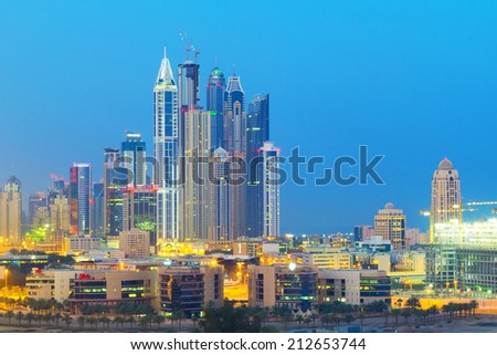 DUBAI, UAE - 31 MARCH 2014: Downtown of Dubai at dusk, UAE. Dubai is the most populous city in the United Arab Emirates with 2,1 million people. - stock photo