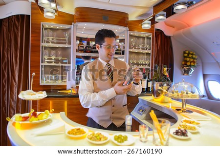 DUBAI, UAE - MARCH 31, 2015: Emirates Airbus A380 interior. Emirates is one of two flag carriers of the United Arab Emirates along with Etihad Airways and is based in Dubai. - stock photo