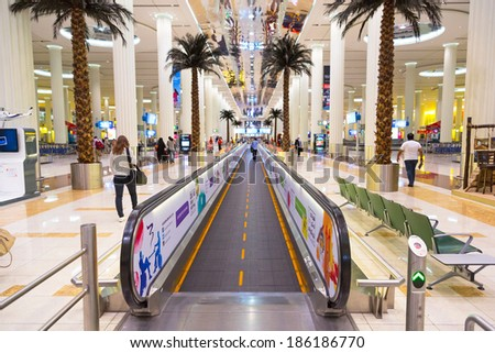 DUBAI, UAE - MARCH 24: Interior of terminal 3 at Dubai International Airport on March 24, 2014. This is the worlds largest airport terminal with over 1,713,000 m2 exclusively for Emirates airlines. - stock photo