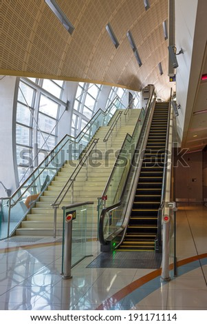 DUBAI, UAE - MARCH 28, 2014: Jumeirah Lakes Tower metro station interior view. The JLT is a large development which consists of 79 towers being constructed along the edges of 4 artificial lakes.
