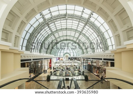 DUBAI, UAE - MARCH 10: Large glass ceiling in the Mall of the Emirates on March 10, 2016 in Dubai. Mall of the Emirates is a shopping mall in the Al Barsha district of Dubai.