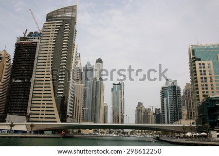 DUBAI, UAE - MARCH 23 - 2015 : Modern buildings in Dubai Marina, Dubai, UAE. In the city of artificial channel length of 3 kilometers along the Persian Gulf, taken on 23 March 2015 in Dubai.