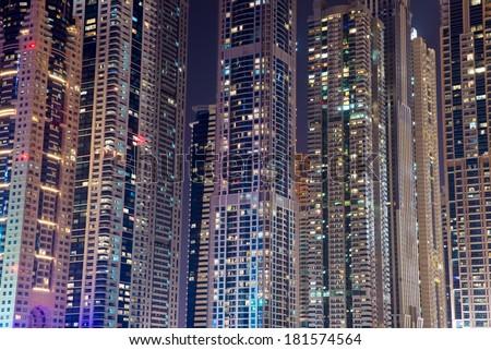 DUBAI, UAE - 3 MARCH, 2014: Modern skyscrapers in Dubai Marina, close up, in Dubai, UAE. Here is the tallest residential building in the world. March  3, 2014 Dubai, UAE. - stock photo