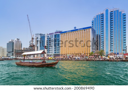 DUBAI, UAE - MARCH 31: Port Saeed along Deira's shore of Dubai Creek on 31 March 2014, UAE. Deira is an old commercial center of Dubai with small shipping and trade boats on the Dubai Creek.