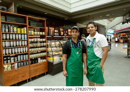 DUBAI, UAE - MARCH 10, 2015: Starbucks staff. Starbucks Corporation, doing business as Starbucks Coffee, is an American global coffee company and coffeehouse chain based in Seattle, Washington