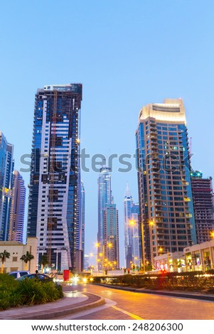 DUBAI, UAE - MARCH 30: Traffic on the streets of Dubai Marina on March 30, 2014, UAE. Dubai Marina is a district in Dubai with artificial canal skyscrapers who accommodates more than 120,000 people. - stock photo