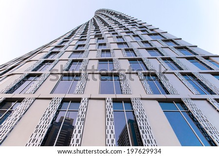 DUBAI, UAE - 3 MARCH, 2014: Twisted modern building in Dubai Marina. Elite residential area in Dubai. March  3, 2014 Dubai, UAE. - stock photo