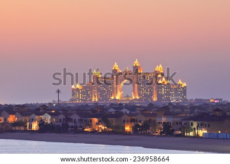 DUBAI, UAE - MARCH 1: View of the luxury hotel Atlantis The Palm on March 1, 2013  in Dubai, United Arab Emirates. Shot from the Palm Jumeirah at sunset. - stock photo