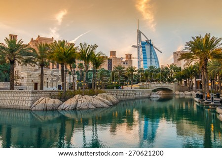 Dubai, UAE - March 29, 2015: View on Burj Al Arab from Madinat Jumeirah during sunset. Madinat is a luxury resort which include hotels and souk spreding across over 40 hectars. - stock photo